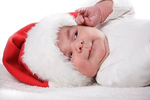 Newborn baby in Santa hat closeup
