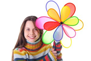 Girl with colorfull pinwheel isolate