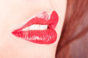 Red lips smile closeup with white te