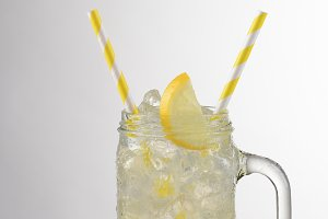 Lemonade Glass With Yellow Straws