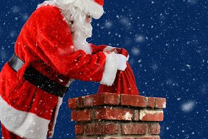 Santa Claus Placing Bag in Chimney