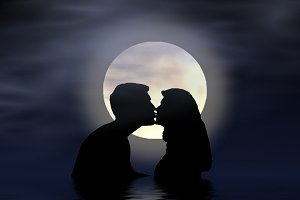 couple kiss in moonlight