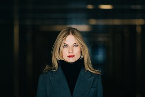 Photo of young blonde in coat in