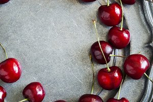 Sweet cherry on vintage plate.