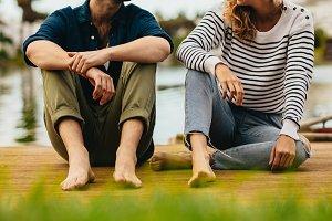 Couple on date sitting near a lake