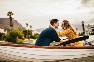 Romantic couple in love on a boat