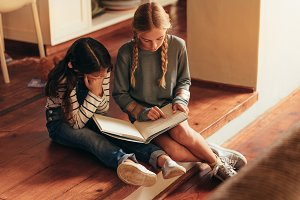 Girl reading storybook