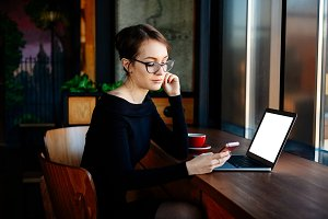 Woman in glasses works on a laptop