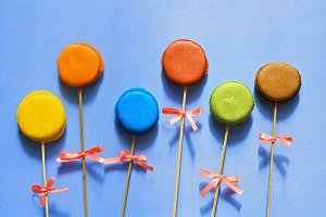 Multi-colored macaroons on a stick