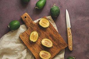 Feijoa fruit cut in halves on a