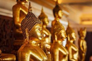 Golden Buddha statues in buddhist