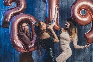 Female friends celebrating playing