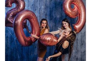 Beautiful young women celebrating