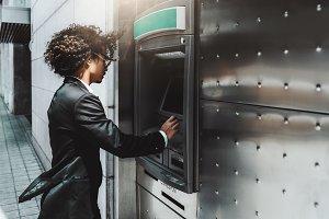 Man entrepreneur is using ATM