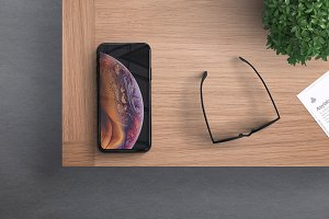 iPhone XS in Desk Mockup - PSD