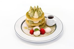 Pancake stack with green tea, syrup