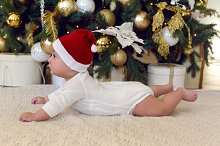 child in a red cap for Christmas is