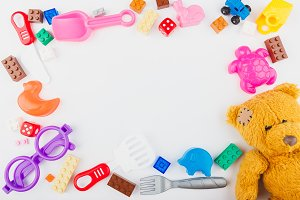 Kids toys background with teddy bear