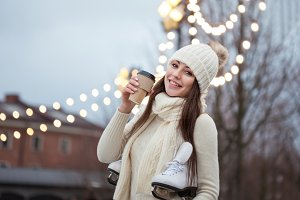 Happy young woman in knitted sweater