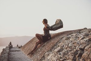 Woman sitting on stones in