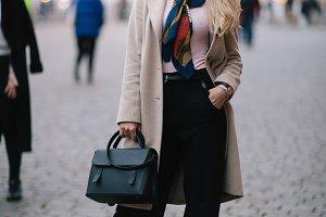 Photo of full-length blonde in coat