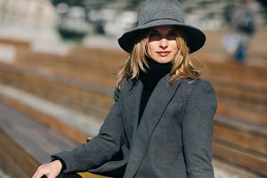 Photo of young blonde in gray coat
