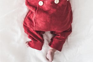 Infant Child in a Red Outfit