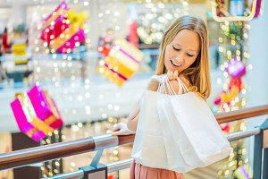 Young woman in Christmas mall with