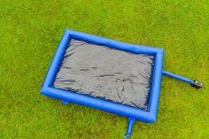 Big inflatable blue trampoline on