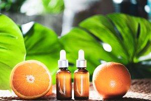 Bottles with orange oil, fresh