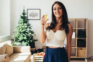 New Year. Young woman with a glass