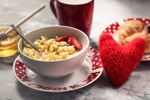 Cereal, honey for breakfast with red