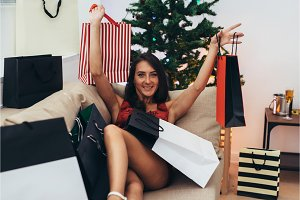 Young woman with shopping bags near