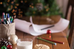 A glass of milk and cookies. New Yea