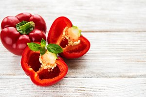 Bell peppers on a wooden background