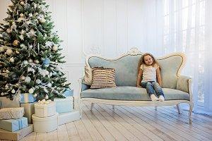 Beautiful girl sitting on the sofa