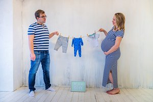 Young couple: pregnant woman and man