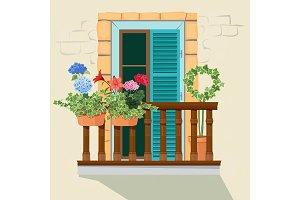 Balcony flowers. House facade window