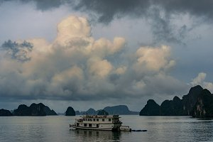 Sunset over Ha Long Bay with cruise