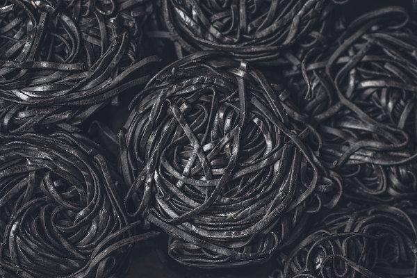 Background with fresh black pasta