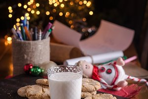 A glass of milk and sugar cookies in