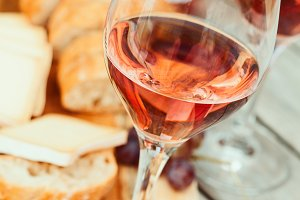 Two glasses of rose wine and board w