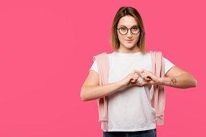 woman in eyeglasses on pink