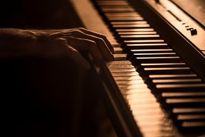 male hands on the piano keys closeup