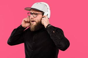 bearded male hipster listening music