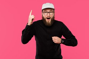excited bearded man in eyeglasses an