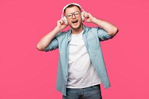 happy young man in eyeglasses listen
