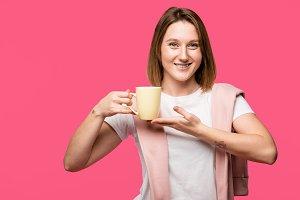 beautiful young woman holding mug an