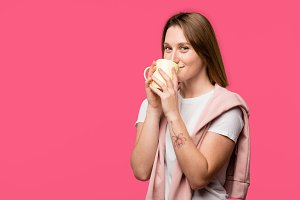 young woman drinking from cup and lo