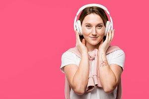 happy young woman in headphones list